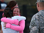 Event organizer Laura Boldry, center, hugs Tracy Kelly after completing a memorial 5K walk and run in honor of the victims of the 2011 IHOP shooting in Carson City, Nev., on Friday, Sept. 6, 2013.  Kelly is the widow of Nevada National Guard Lt. Col. Heath Kelly who was one of four people killed when Eduardo Sencion opened fire in the restaurant before killing himself in the parking lot. Nine others were wounded in the attack.<br /> Photo by Cathleen Allison