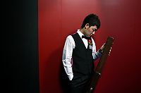 CHINA. Beijing. Chinese snooker player Tian Pengfei backstage just before going to play at the China Snooker Open. Snooker is a cue sport played on a large table measuring 3.6 metres x 1.8 metres. Originating in India in the late 19th Century where it was invented by British Army officers, the game has been a mainstay in British sport over the past few decades. Recently however, popularity of the sport has declined as the sport struggles to compete with other popular sports. The sport is however flourishing in countries such as China, where it is now the second most popular sport, behind Basketball. In a country where the  players are treated like movie-stars, China may be the great hope for the sports recovery. 2009