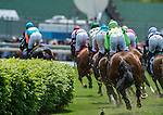 May 3, 2014: Riders round the first turn of the Churchill Distaff Turf Mile Stakes on Kentucky Derby Day at Churchill Downs in Louisville, KY. Logan Riely/ESW/CSM