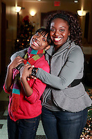 Sisters Merli Desrosier, 25, and Marie Estime, 16, pose together at the New York Foundling bldg. in Manhattan, NY on Friday, December 18, 2009.  Desrosier is in the process of adopting her younger sister.