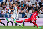 Lucas Vazquez (l) of Real Madrid battles for the ball with David Alaba of FC Bayern Munich during their 2016-17 UEFA Champions League Quarter-finals second leg match between Real Madrid and FC Bayern Munich at the Estadio Santiago Bernabeu on 18 April 2017 in Madrid, Spain. Photo by Diego Gonzalez Souto / Power Sport Images