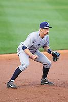 Wilmington Blue Rocks third baseman Hunter Dozier (18) on defense against the Winston-Salem Dash at BB&T Ballpark on April 5, 2014 in Winston-Salem, North Carolina.  The Dash defeated the Blue Rocks 3-2.  (Brian Westerholt/Four Seam Images)