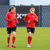 Aster Janssens and Jarne Teulings pictured during the training session of the Belgian Women's National Team ahead of a friendly female soccer game between the national teams of Germany and Belgium , called the Red Flames in a pre - bid tournament called Three Nations One Goal with the national teams from Belgium , The Netherlands and Germany towards a bid for the hosting of the 2027 FIFA Women's World Cup ,on 19th of February 2021 at Proximus Basecamp. PHOTO: SEVIL OKTEM | SPORTPIX.BE