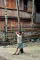 Boy leaning on a tree. Malibcong, Abra. August, 1999