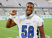 Armwood Hawks defensive lineman Byron Cowart #58 poses for a photo after the Florida High School Athletic Association 6A Championship Game at Florida's Citrus Bowl on December 17, 2011 in Orlando, Florida.  Armwood defeated Miami Central 40-31.  (Photo By Mike Janes Photography)