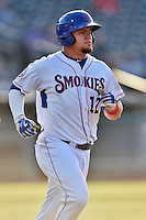 Tennessee Smokies catcher Kyle Schwarber (12) runs to first during a game against the Mobile BayBears on May 27, 2015 in Kodak, Tennessee. The Smokies defeated the BayBears 3-2. (Tony Farlow/Four Seam Images)
