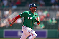 Boston Red Sox J.D. Martinez (28) running the bases during a Major League Spring Training game against the Minnesota Twins on March 17, 2021 at JetBlue Park in Fort Myers, Florida.  (Mike Janes/Four Seam Images)