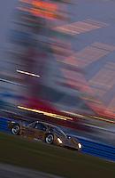Rolex 24 at Daytona, Daytona International Speedway 5/6 Feb, 2005.The #77 Lexus Doran speeds past the infield's ferris wheel on its way to 5th place..Copyright©F.Peirce Williams 2005