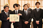 """March 4, 2020, Tokyo, Japan - Japanese Foreign Minister Toshimitsu Motegi (L) smiles with members of pop group """"GENERATIONS from EXILE TRIBE"""" as Generations members are named to Japan-United Arab Emirates (UAE) goodwill ambassador by Japanese foreign ministry at Motegi's office in Tokyo on Wednesday, March 4, 2020.   (Photo by Yoshio Tsunoda/AFLO)"""