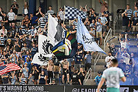 KANSAS CITY, KS - AUGUST 10: Sporting KC fans waving flags after a goal has been scored during a game between Club Leon and Sporting Kansas City at Children's Mercy Park on August 10, 2021 in Kansas City, Kansas.