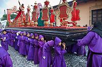 Antigua, Guatemala.  Adolescent Boys Carrying a Float (Anda) in a Religious Procession during Holy Week, La Semana Santa.