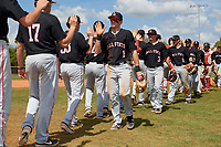 Ball State Cardinals Aaron Simpson (1), Noah Powell (3), Noah Navarro (8), and John Ricotta (31) high five teammates after a game against the Saint Joseph's Hawks on March 9, 2019 at North Charlotte Regional Park in Port Charlotte, Florida.  Ball State defeated Saint Joseph's 7-5.  (Mike Janes/Four Seam Images)