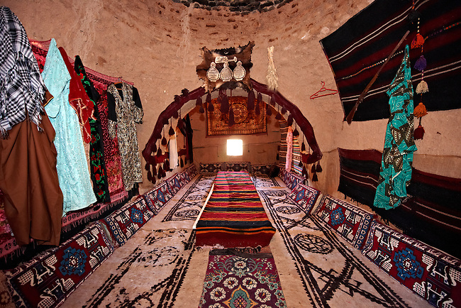 """Pictures of the beehive adobe buildings of Harran, south west Anatolia, Turkey.  Harran was a major ancient city in Upper Mesopotamia whose site is near the modern village of Altınbaşak, Turkey, 24 miles (44 kilometers) southeast of Şanlıurfa. The location is in a district of Şanlıurfa Province that is also named """"Harran"""". Harran is famous for its traditional 'beehive' adobe houses, constructed entirely without wood. The design of these makes them cool inside. 5"""