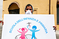 Flashmob of the peer schools in Montecitorio Square, near the Chamber of Deputies, to protest against the closure of the schools. The protesters put backpacks on the ground, many of them pink, to recall an indispensable object used by the students. As in Italy most of the peer schools are managed by Catholic religious institutes, many nouns participated to the demonstration. Rome (Italy), June 18th 2020<br /> Samantha Zucchi Insidefoto