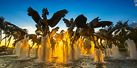 Colorful sunset with light rays through the pegasus water fountain in front of the Atlantis Hotel and Casino in Paradise Island, Nassau, Bahamas