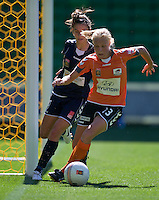 MELBOURNE, AUSTRALIA - DECEMBER 4: Tameka Butt of the Roar and Stephanie Catley of the Victory compete for the ball in front of Roar's goal during round 5 of the Westfield W-league match between Melbourne Victory and Brisbane Roar on 4 December 2010 at AAMI Park in Melbourne, Australia. (Photo Sydney Low / asteriskimages.com)
