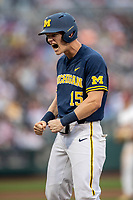 Michigan Wolverines first baseman Jimmy Kerr (15) celebrates driving in their second run against the Florida State Seminoles during the NCAA College World Series on June 17, 2019 at TD Ameritrade Park in Omaha, Nebraska. Michigan defeated Florida State 2-0. (Andrew Woolley/Four Seam Images)