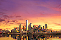 """""""Dallas Skyline at Sunrise with Reflection"""" – Glowing in the early morning light, sunrise envelops the radiant Dallas skyline in incandescent warmth with colors of aureolin, saffron, lavender, wisteria, and marigold. In the foreground, a flooded Trinity River winds past the city, revealing a rarely photographed moment of the beautiful Dallas skyline. (Photo/Stephen A. Masker)"""