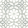 Estelle, a waterjet stone and Serenity glass mosaic, shown in honed Thassos and Tropical White glass, is part of the Parterre Collection by New Ravenna.