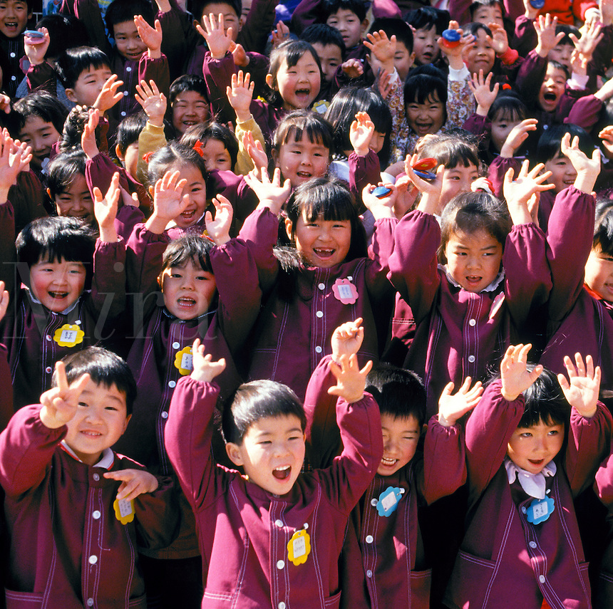 Smiling young school children participating in play activities in Japan. kids. Japan.