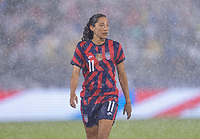 EAST HARTFORD, CT - JULY 1: Christen Press #11 of the USWNT stands in the rain during a game between Mexico and USWNT at Rentschler Field on July 1, 2021 in East Hartford, Connecticut.