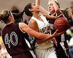 Waterbury, CT- 30, December 2010-123010CM12 Holy Cross' Brianna Kiera O'Donnell gets fouled by Torrignton's Sarah Royals (#40) Thursday night in Waterbury. Defending is Torrington's Nicole Kozlak (right). Holy Cross defeated Torrington, 50-44 to remain undefeated on the season. Christopher Massa Republican-American