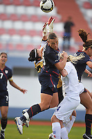 US forward #20 Abby Wambach collides with Iceland goalie #1 Thora Helgadottir during a game vs Iceland in the 2010 Algarve Cup in Portugal.