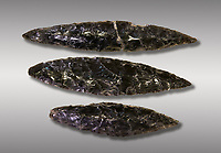 Black obsidian blades. Catalhoyuk Collections. Museum of Anatolian Civilisations, Ankara. Against a grey background