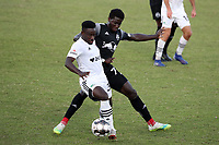RICHMOND, VA - SEPTEMBER 30: Akeem Ward #30 of North Carolina FC is defended by Cherif Dieye #70 of New York Red Bulls II during a game between North Carolina FC and New York Red Bulls II at City Stadium on September 30, 2020 in Richmond, Virginia.