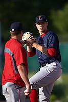 Lowell Spinners pitcher Tanner Houck (50) works in the bullpen with pitching coach Lance Cater (left) before a game against the Batavia Muckdogs on July 11, 2017 at Dwyer Stadium in Batavia, New York.  Lowell defeated Batavia 5-2.  (Mike Janes/Four Seam Images)