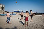 UKRAINE, Mariupol: Young men are playing volleyball on the beach as it's the first week o summer holiday. <br /> <br /> UKRAINE, Mariupol: Des jeunes hommes jouent au volley-ball sur une des plages de Mariupol. C'est la première semaine des vacances d'été.