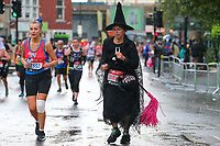 3rd October 2021; London, England: The Virgin Money 2021 London Marathon: Fancy dress runner on Butcher Row, Limehouse between mile 21 and 22 starting towards central London and the finish.