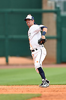 NW Arkansas Naturals shortstop Logan Davis (4) throws to first during a game against the Corpus Christi Hooks on May 26, 2014 at Arvest Ballpark in Springdale, Arkansas.  NW Arkansas defeated Corpus Christi 5-3.  (Mike Janes/Four Seam Images)