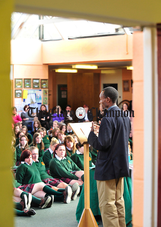 Fr Mysaky from the island of Pemba near Tanzania chats speaks to students from Schoil Mhuire in Ennistymon on Wednesday. Fr Msaky was presented with a cheque for Ä10,635, money raised by students of the school for projects in Pemba. Photograph by Declan Monaghan