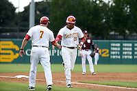 Timmy Robinson (28) of the Southern California Trojans is greeted by third base coach Gabe Alvarez (7) after hitting a home run during a game against the Mississippi State Bulldogs at Dedeaux Field on March 5, 2016 in Los Angeles, California. Mississippi State defeated Southern California , 8-7. (Larry Goren/Four Seam Images)