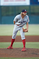 Lakewood BlueClaws relief pitcher Andrew Schultz (23) looks to his catcher for the sign against the Kannapolis Intimidators at Kannapolis Intimidators Stadium on July 18, 2019 in Kannapolis, North Carolina. The Intimidators defeated the BlueClaws 7-1. (Brian Westerholt/Four Seam Images)