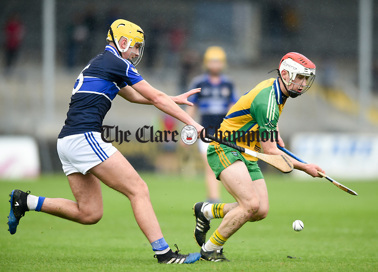 Bradley Higgins of Kilmaley in action against Eoin Fitzgerald of Inagh-Kilnamona during their Minor A county final at Cusack Park. Photograph by John Kelly.