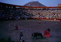 The October Festival of Bullfighting in Lima honors the Lord of Miracles. Spanish costumed matadors with red capes fight bulls in the historic Plaza de Acho ring. They follow tradition to fight to the death.