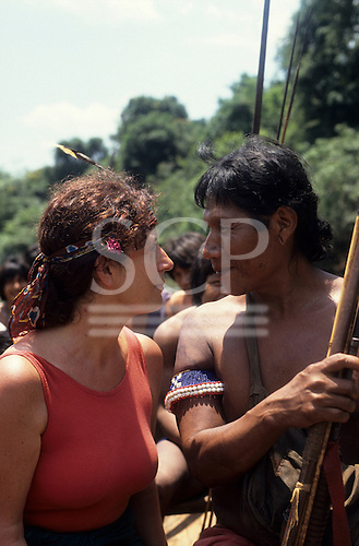 A-Ukre Village, Brazil. Anita Roddick of the Body Shop staring at a Kayapo friend on a fishing trip. 1990.