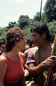 A-Ukre Village, Brazil. Anita Roddick of the Body Shop staring at a Kayapo friend on a fishing trip. 1990.