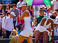 London, England, 6 th. July, 2018, Tennis,  Wimbledon, Womans singel third round,  Venus Williams (USA) is passed by in her match against Kiki Bertens (NED) (L)<br /> Photo: Henk Koster/tennisimages.com