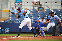 Charlotte Stone Crabs outfielder Yoel Araujo (28) at bat in front of catcher Derrick Chung and umpire Joe George during a game against the Dunedin Blue Jays on July 26, 2015 at Charlotte Sports Park in Port Charlotte, Florida.  Charlotte defeated Dunedin 2-1 in ten innings.  (Mike Janes/Four Seam Images)