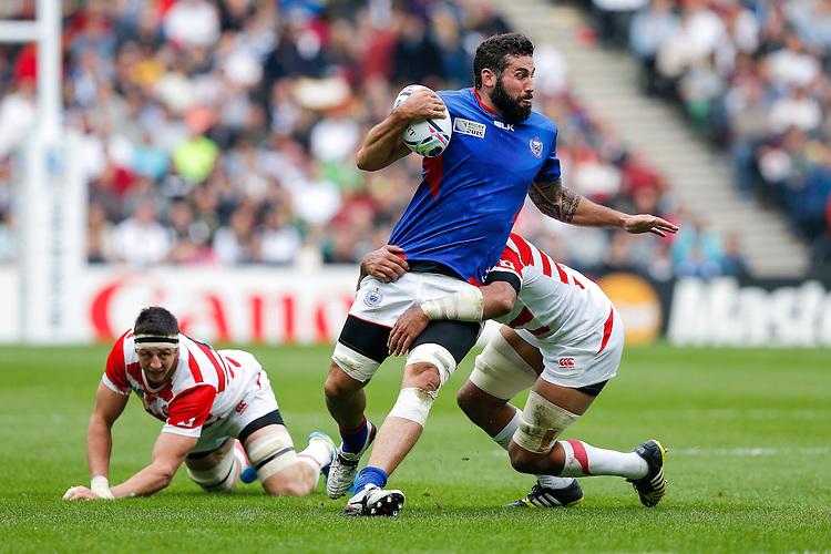 Samoa Lock Kane Thompson is tackled - Mandatory byline: Rogan Thomson - 03/10/2015 - RUGBY UNION - Stadium:mk - Milton Keynes, England - Samoa v Japan - Rugby World Cup 2015 Pool B.