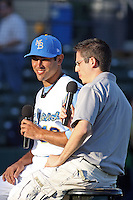 Myrtle Beach Pelicans pitcher Jimmy Reyes #13 being interviewed for the pre-game radio show of the Myrtle Beach Pelicans by Pelicans radio announcer Joel Godett before a game against the Potomac Nationals at Tickerreturn.com Field at Pelicans Ballpark on April 12, 2012 in Myrtle Beach, South Carolina. Myrtle Beach defeated Potomac by the score of 1-0. (Robert Gurganus/Four Seam Images)