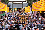 Visitors watch a procession of a portable shrine carried on the shoulder of participants during the annual ''Mitama Festival'' at Yasukuni Shrine on July, 13, 2015, Tokyo, Japan. Over 30,000 lanterns line the entrance to the shrine to help spirits find their way during the annual celebration for the spirits of ancestors. The festival is held from July 13th to 16th. (Photo by Rodrigo Reyes Marin/AFLO)