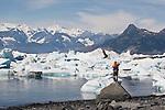 AAlaska, Prince William Sound, Lone sea kayaker standing on glacial erratic, Columbia Bay, Columbia Glacier, pack ice, USA, North America, David Fox, released,.