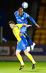 St Johnstone v Queen of the South...21.09.10  CIS Cup 3rd Round.Michael Duberry gets above Derek Holmes.Picture by Graeme Hart..Copyright Perthshire Picture Agency.Tel: 01738 623350  Mobile: 07990 594431