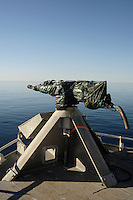 Covered harpoon gun on bow of Norwegian whaling boat. Barents sea, Arctic Norway, North Atlantic.