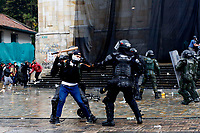 BOGOTA, COLOMBIA - MAY 05: A protester clash with police during national strike on May 5, 2021 in Bogota, Colombia. Despite that the ruling party announced withdrawal of the unpopular bill for a tax reform and the resignation of the Minister of Finances, social unrest continues after a week. The United Nations human rights office (OHCHR) showed its concern and condemned the riot police repression. Ongoing protests take place in major cities since April 28. (Photo by Leonardo Munoz/VIEW press/Corbis via Getty Images)