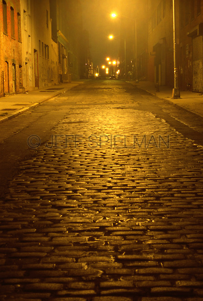AVAILABLE FROM JEFF AS A FINE ART PRINT<br /> <br /> AVAILABLE FOR COMMERCIAL/EDITORIAL LICENSING EXCLUSIVELY FROM GETTY IMAGES.  PLEASE SEARCH FOR IMAGE # a0142-000080 ON WWW.GETTYIMAGES.COM<br /> <br /> Mysterious Illuminated Cobblestone Street Scene at Night, the Vinegar Hill Neighborhood of Brooklyn, New York City, New York State, USA